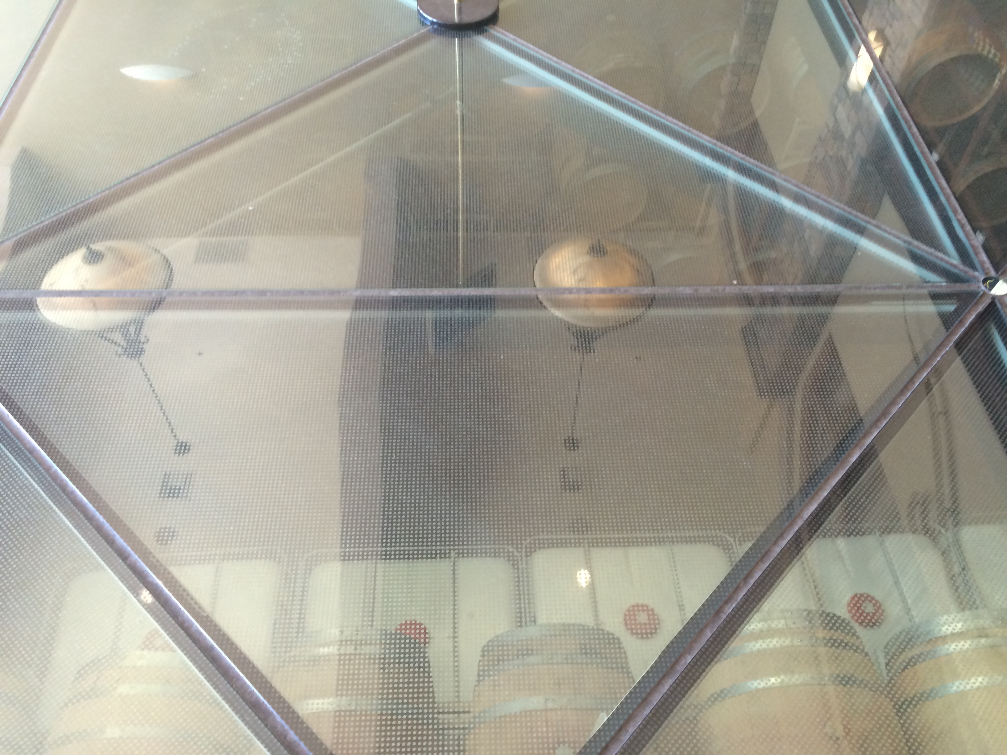 View of the barrel cellar through the glass floor in the tasting room